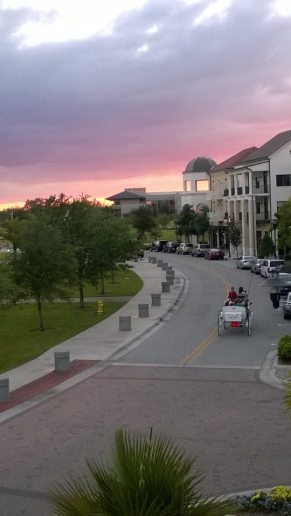 A beautiful evening here in Ave. A family is taking a carriage ride through the town of Ave and enjoying the sunset.
