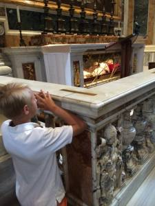 John Paul Allan praying at the tomb of Pope John XXIII the day before his canonization.
