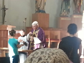 Venice Bishop Frank Dewane distributes Holy Communio at the Ave Maria Oratory assisted by altar boy Joseph Klucik